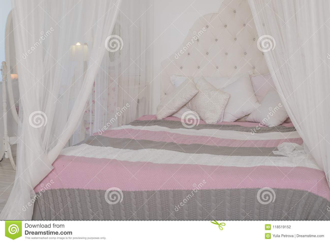 Cozy Bedroom In Light Pastel Colors A Large Four Poster Bed With Pillows Scandinavian Simplicity Design Eco Loft Stock Photo Image Of Beautiful Classic 118519152