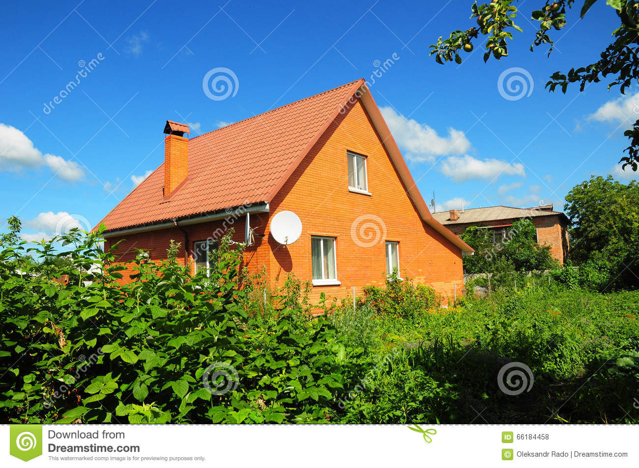 Cozy brick house with old faded red metal roof tile and for Metal roof pictures brick house