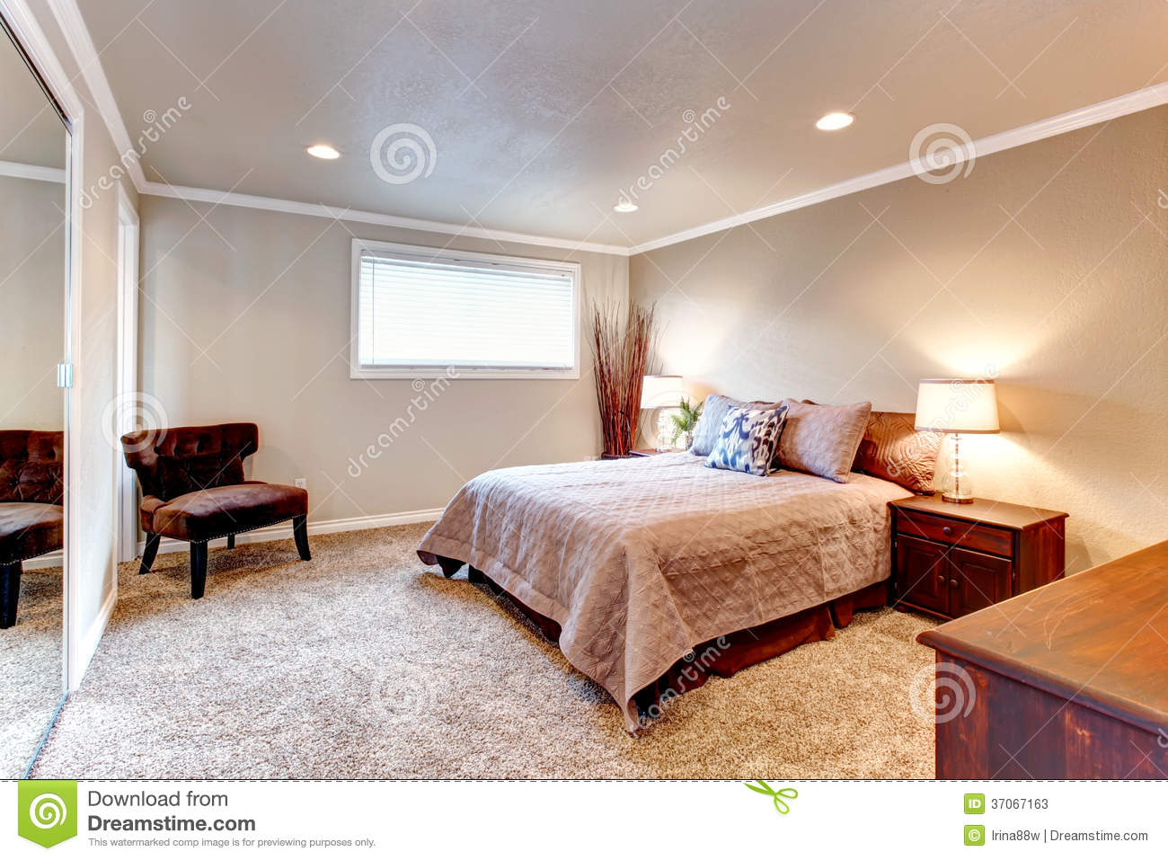 Cozy Brown Tones Bedroom With Wood Furniture And Soft Carpet Stock Photos I