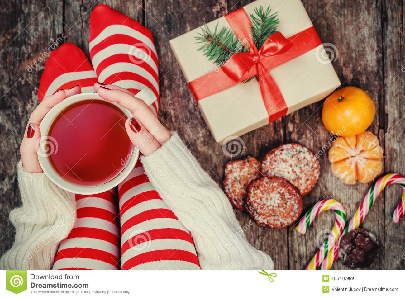 download cozy christmas at home womens feet in christmas stockings big present - Big Christmas Stockings