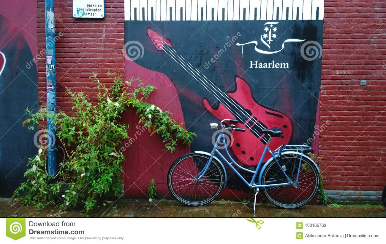 Haarlem netherlands august 30 2017 cozy courtyard of haarlem beautiful graffiti on the wall with a guitar and the inscription with the name of the
