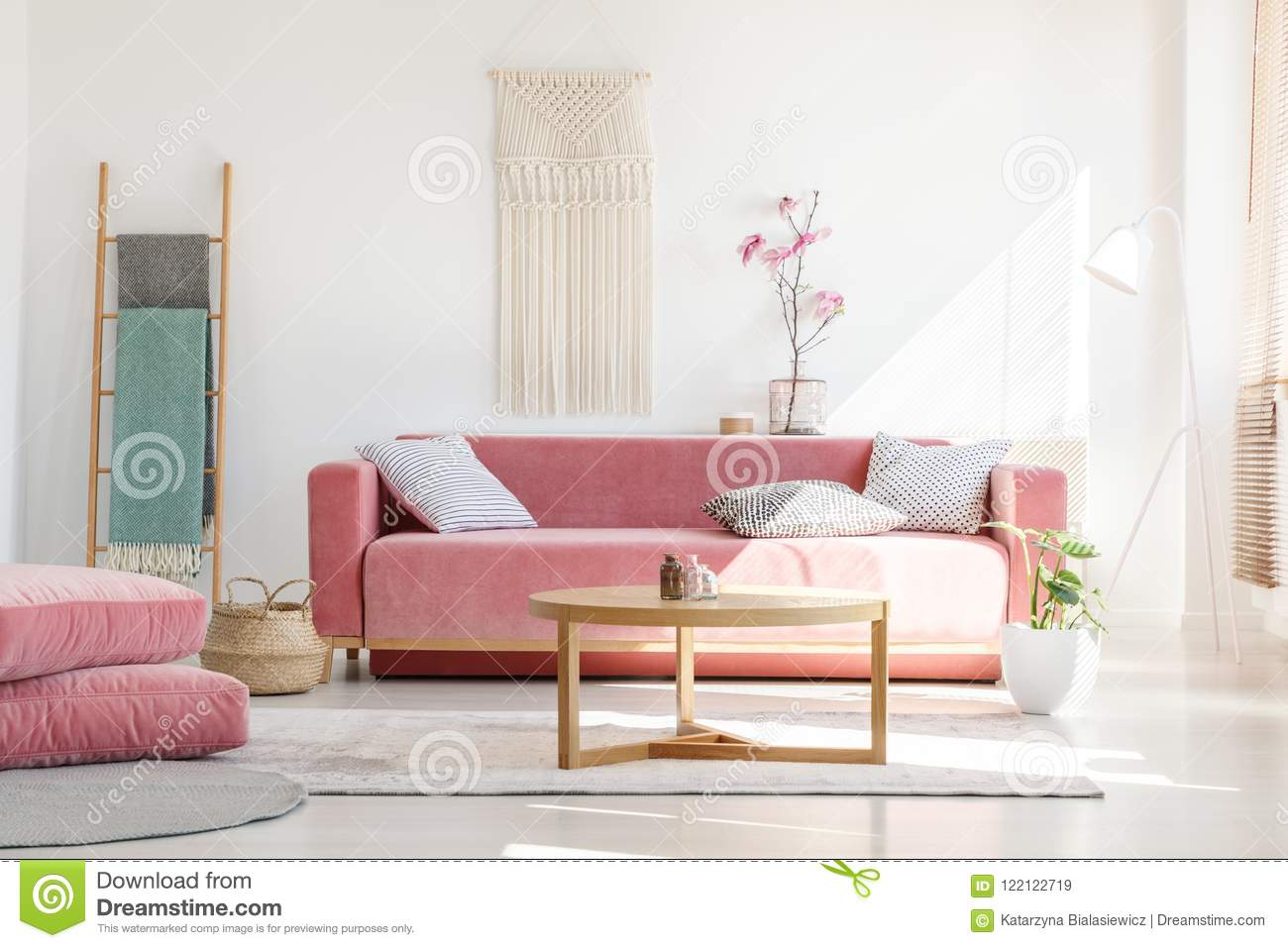 Cozy Cushions And Stylish Textiles In A Sunny, Feminine Living R ...