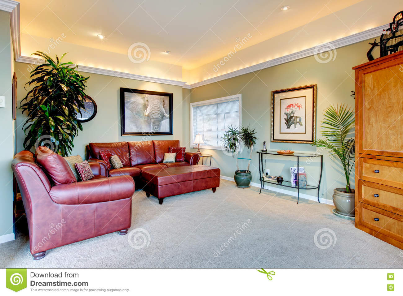 Cozy Family Room With Ivory Walls And Red Leather Sofa Set Stock  ~ Family Room Leather Sofa