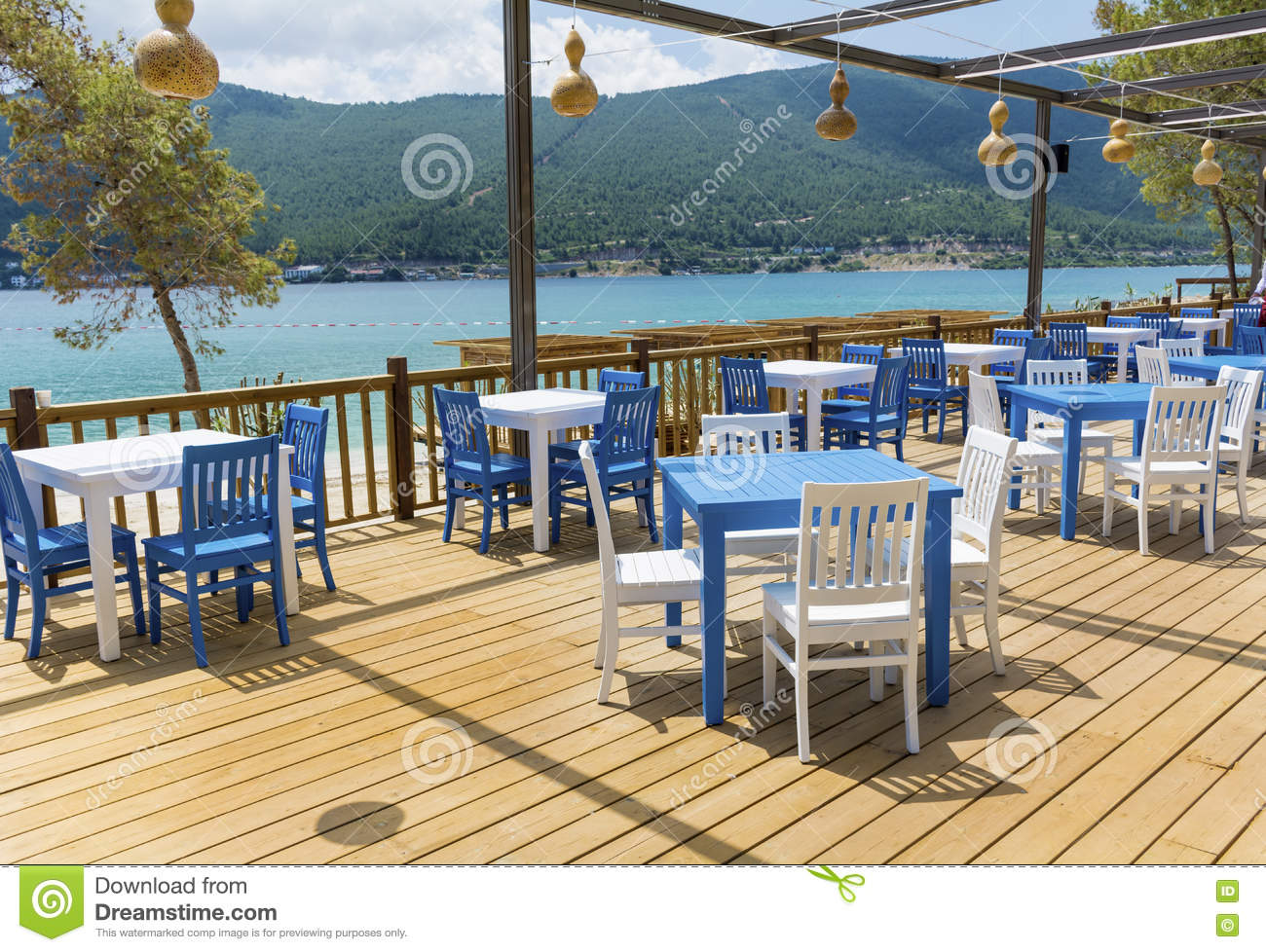 Blue chairs on a greek cafe royalty free stock image