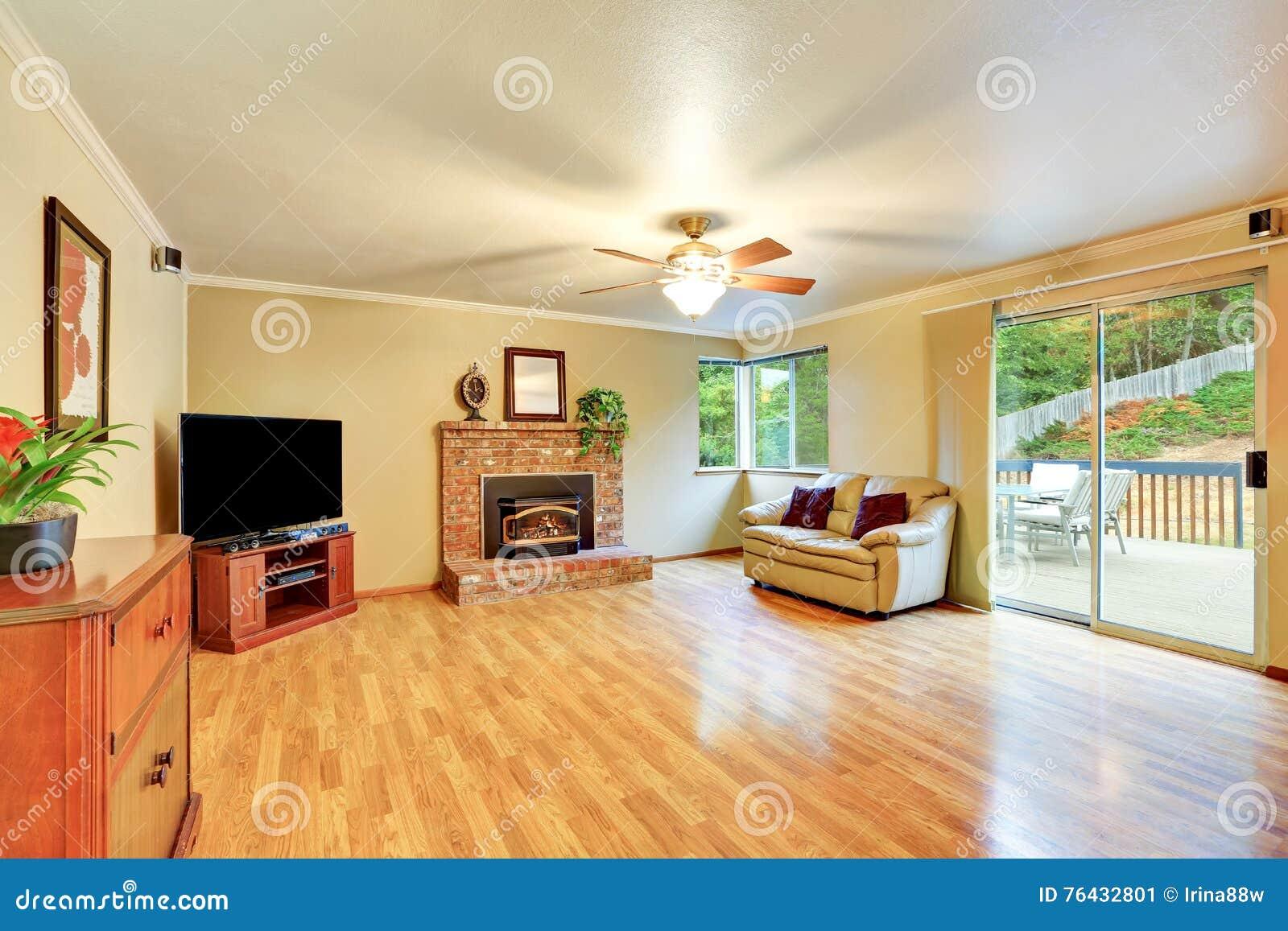 Cozy Hardwood Living Room With Glass Door Exit To The Deck Stock