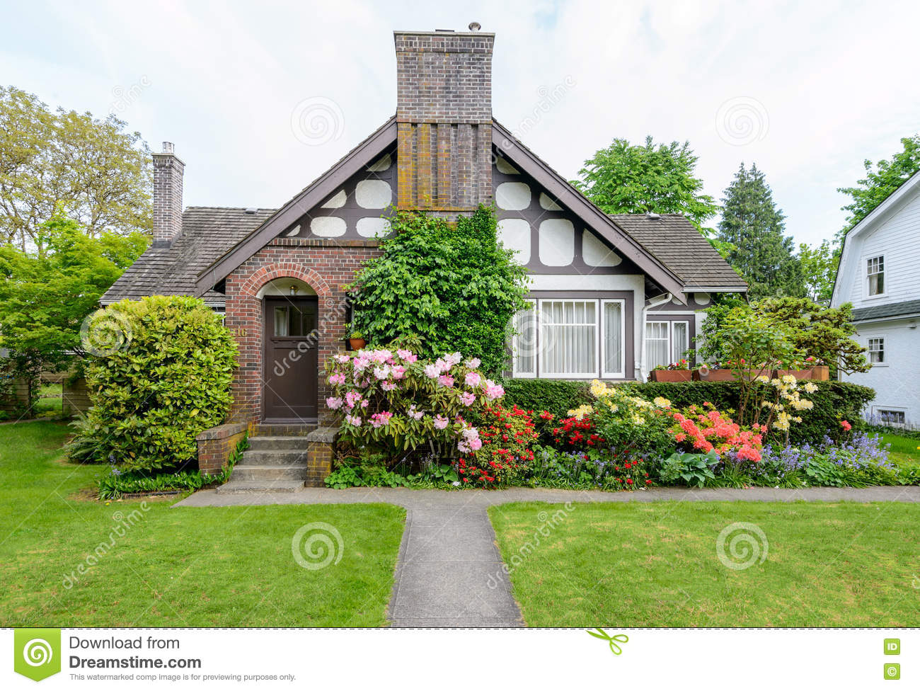 Cozy House With A Beautiful Garden On A Sunny Day Stock Image