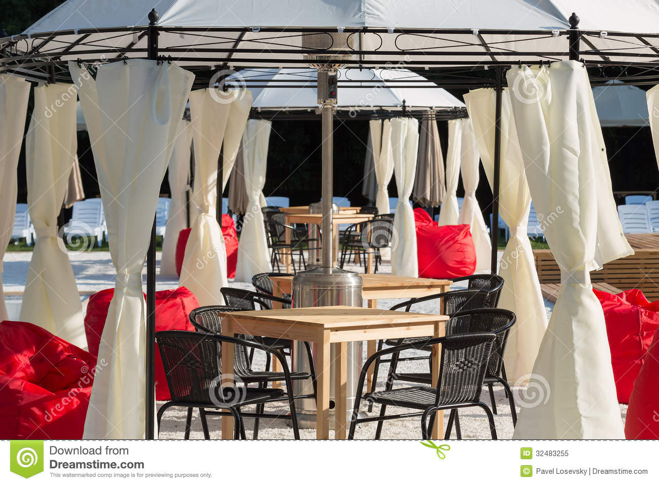 the cozy interior of the open air cafe royalty free stock photo