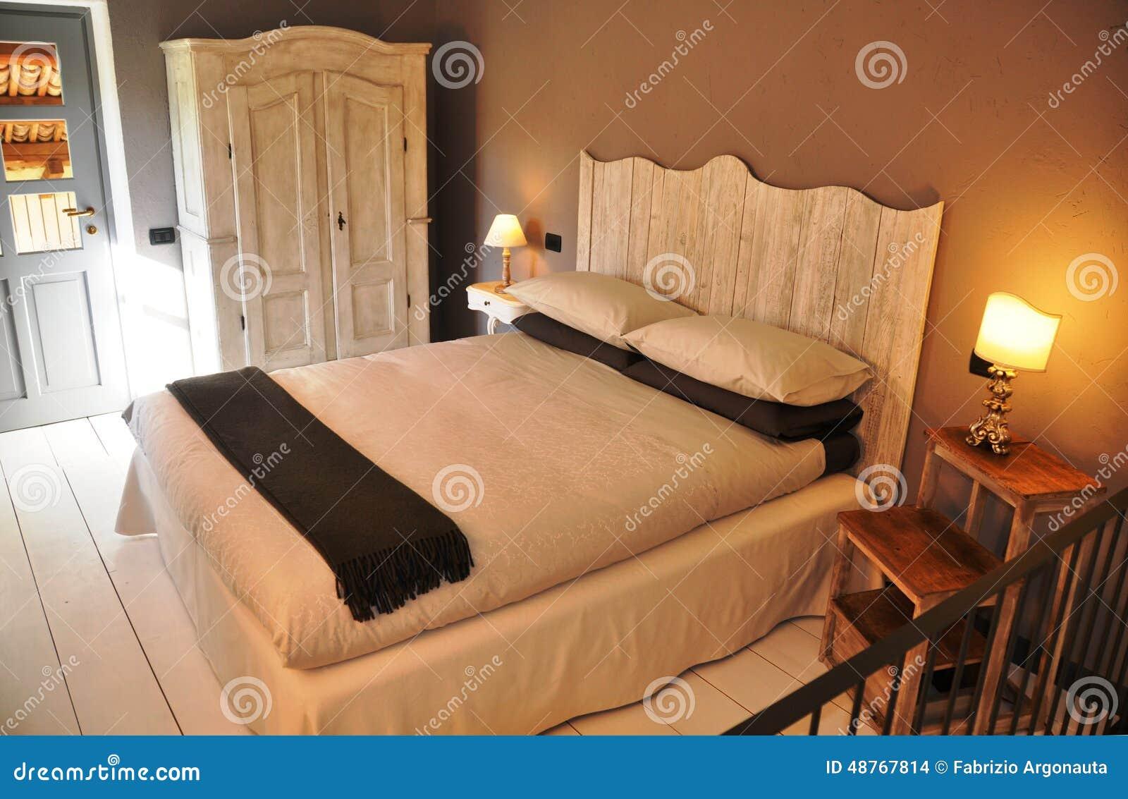 Cozy Italian Country Style Bedroom Stock Photo - Image ...