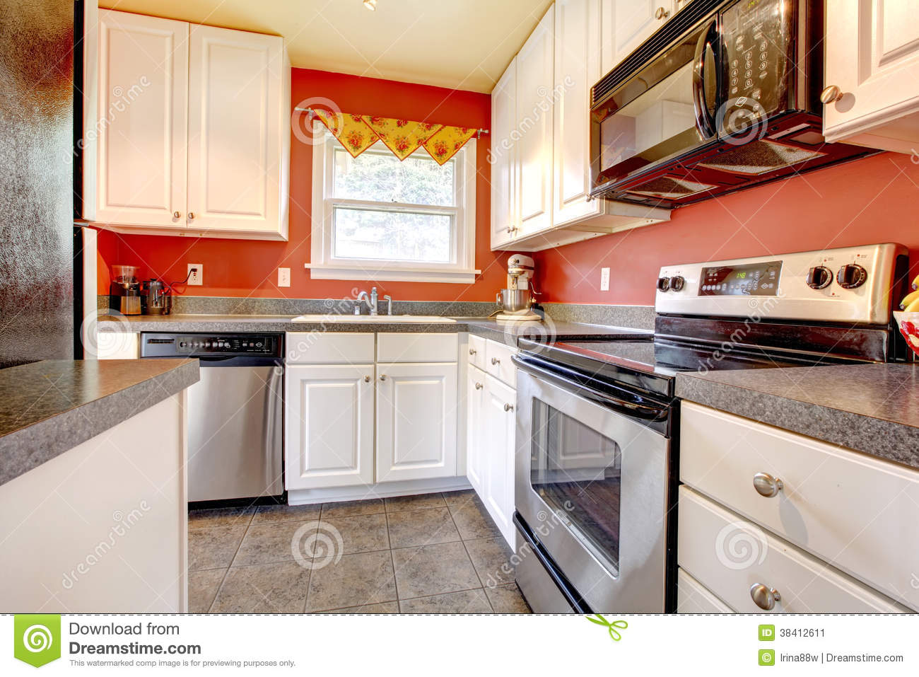 Cozy kitchen room with red wall and white cabinets stock for Kitchen ideas white cabinets red walls