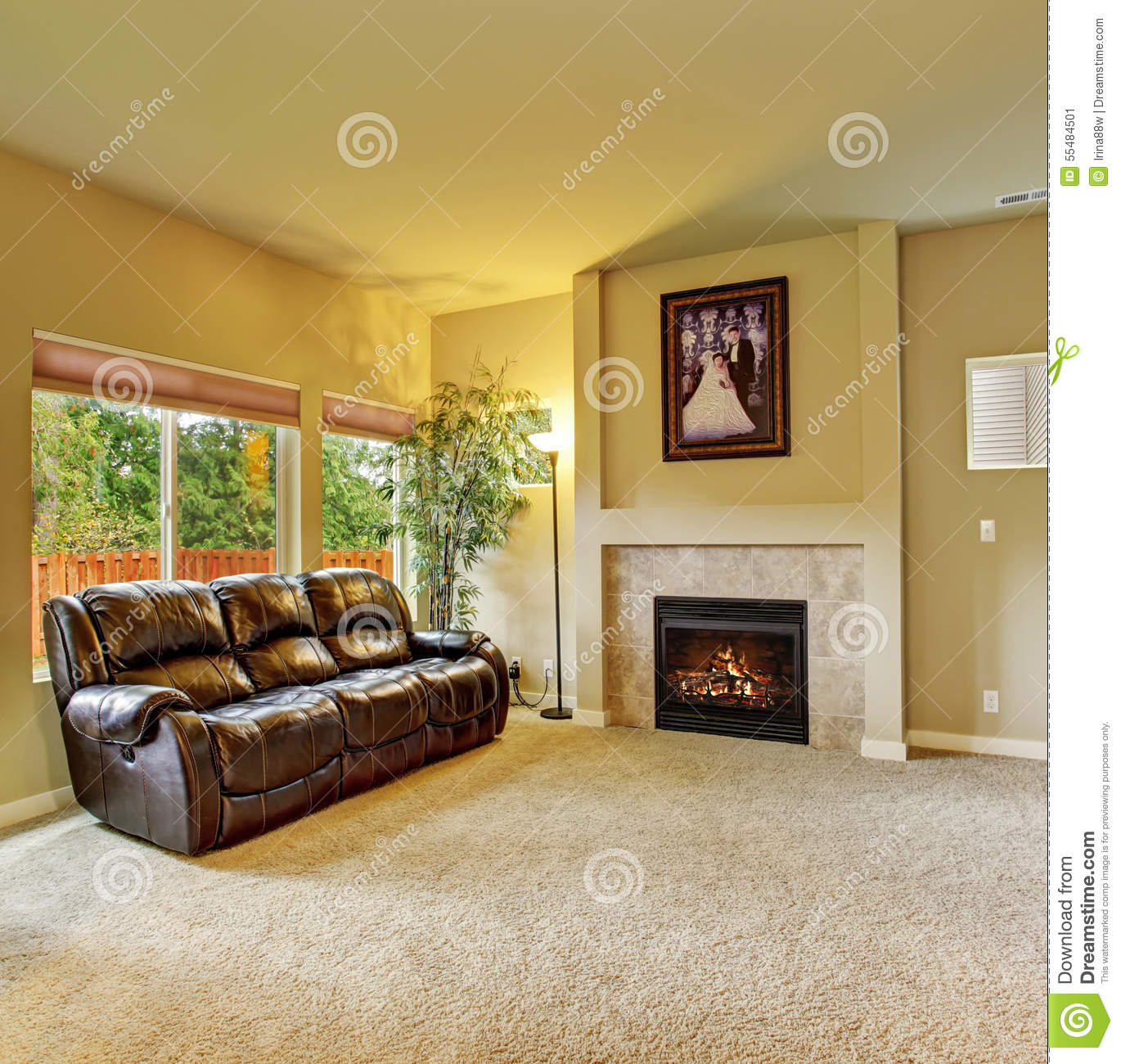 Cozy living room with carpet and fireplace stock photo - Does a living room need a fireplace ...