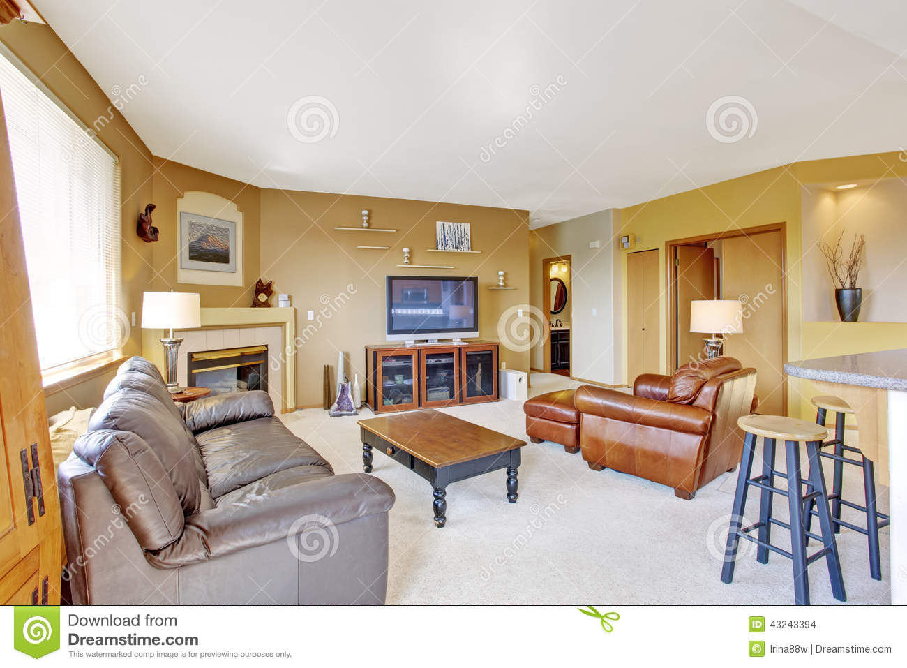 Cozy Living Room With Fireplace And Leather Couch Stock Photo Image