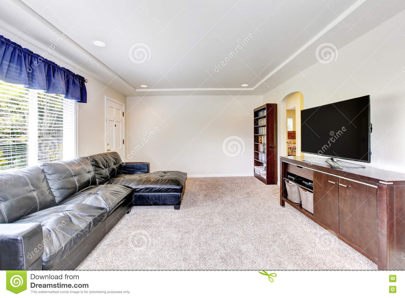 Cozy Living Room Interior With Black Leather Couch And Tv Set Stock ...