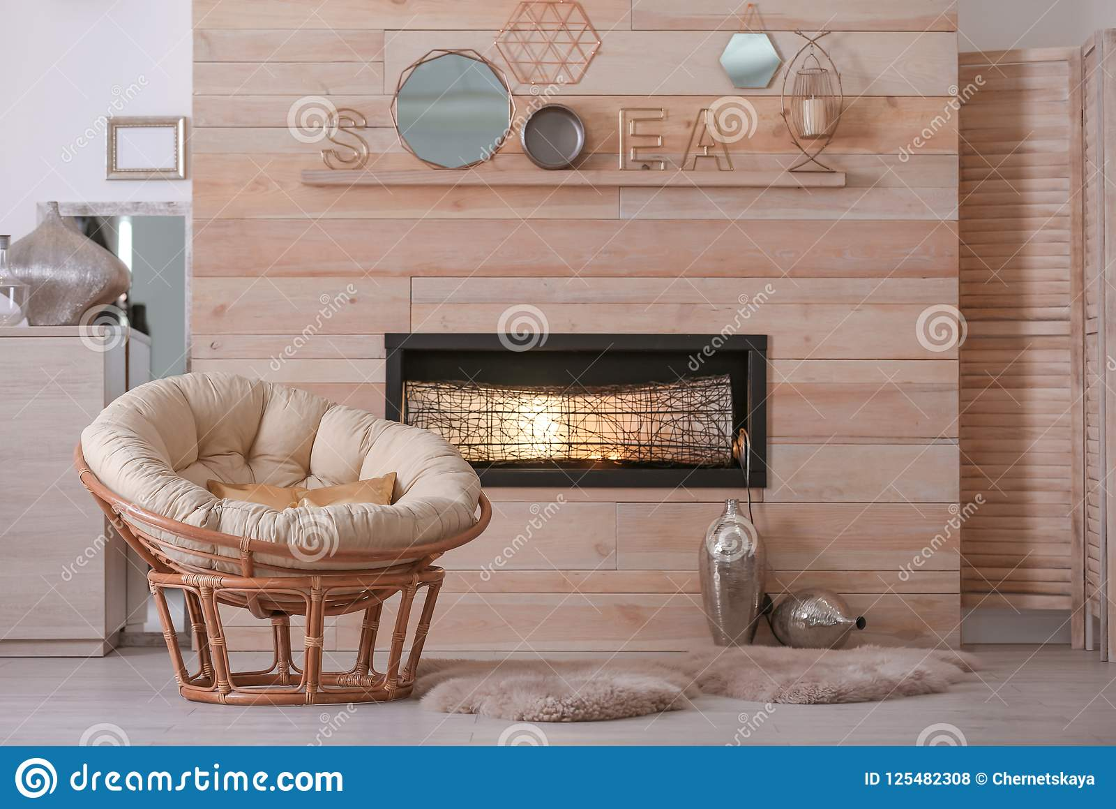 Cozy Living Room Interior With Comfortable Papasan Chair ...