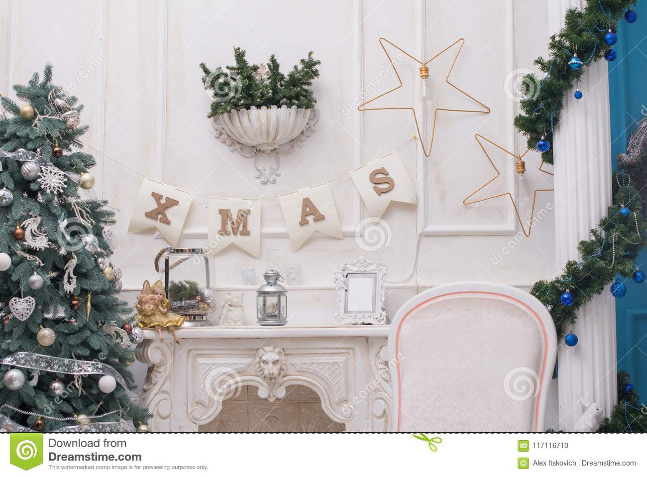 A cozy living room lighted with numerous lights decorated ready to celebrate Christmas. Christmas room interior design