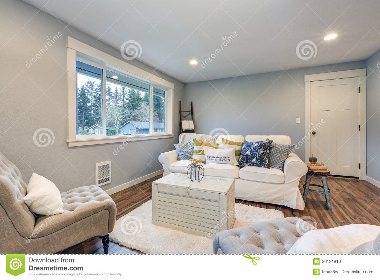 cozy living room space with soft blue grey walls stock photo image