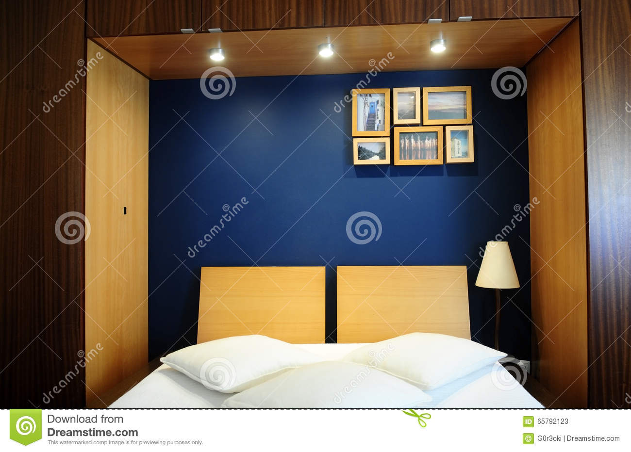 Cozy Bed Room With Blue Wall White Covers And Wooden