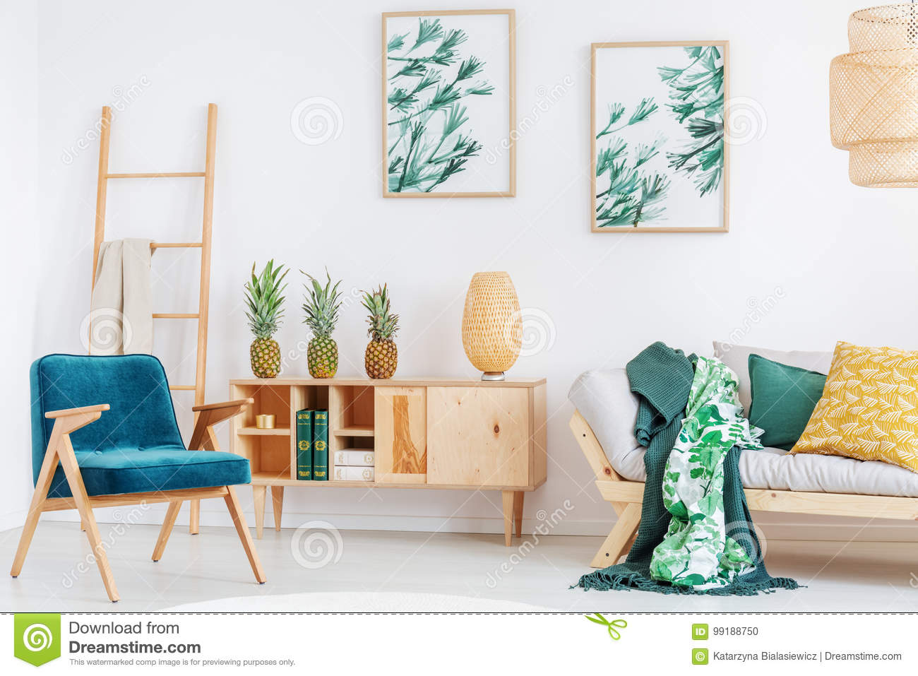 Blue Retro Chair And Yellow Pillow On Beige Sofa In Cozy Room With Pineapples Rustic Cupboard