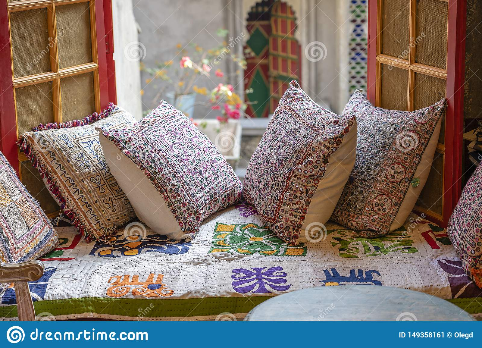 A Cozy Seating Area Near The Window With Colorful Pillows ... Rajasthan Home Design View on ahmedabad homes, south india homes, assam homes, delhi homes, south asia homes, bangalore homes, juhu homes, north india homes, darjeeling homes,
