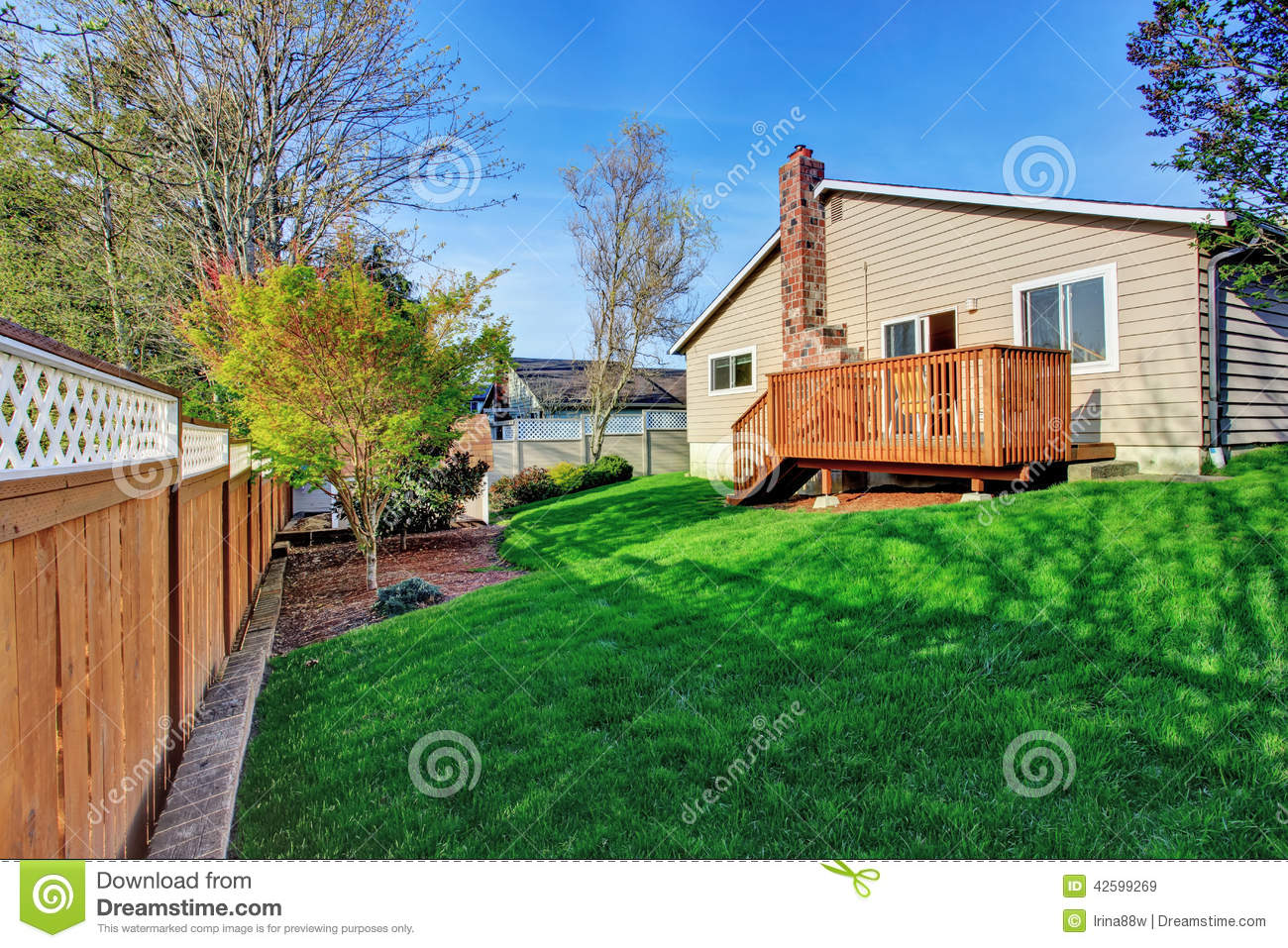 Cozy small backyard with wooden walkout deck stock photo for Wooden decks for small backyards