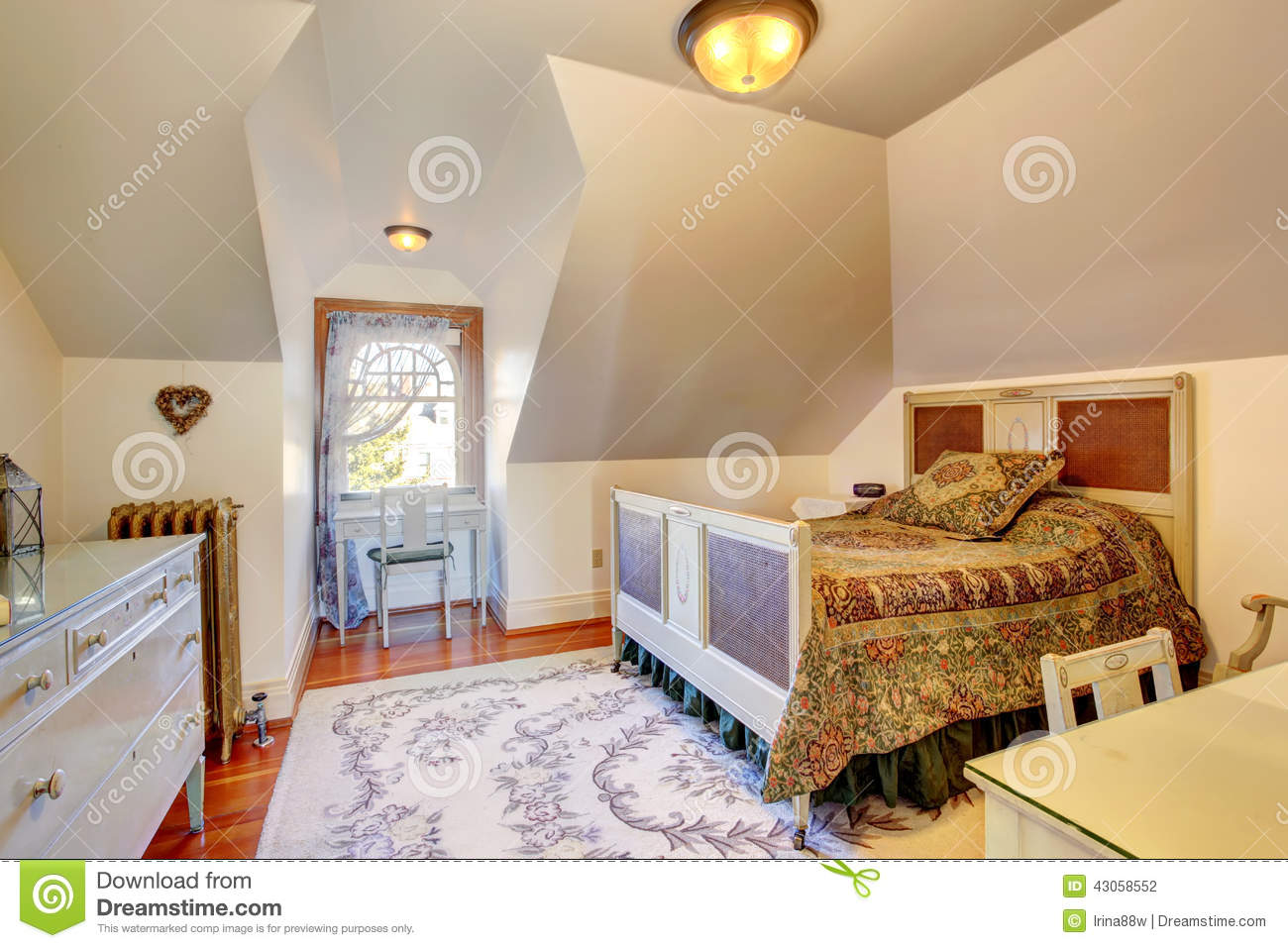 Cozy small bedroom with vaulted ceiling stock photo for Small room vaulted ceiling