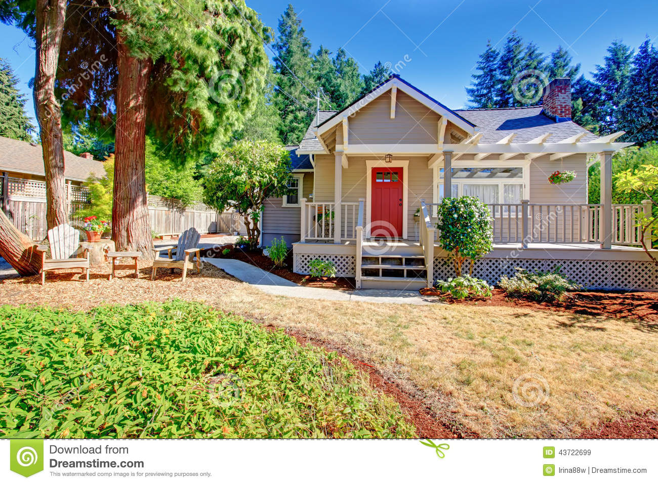 Cozy small house with outdoor rest area stock photo for Front look of small house