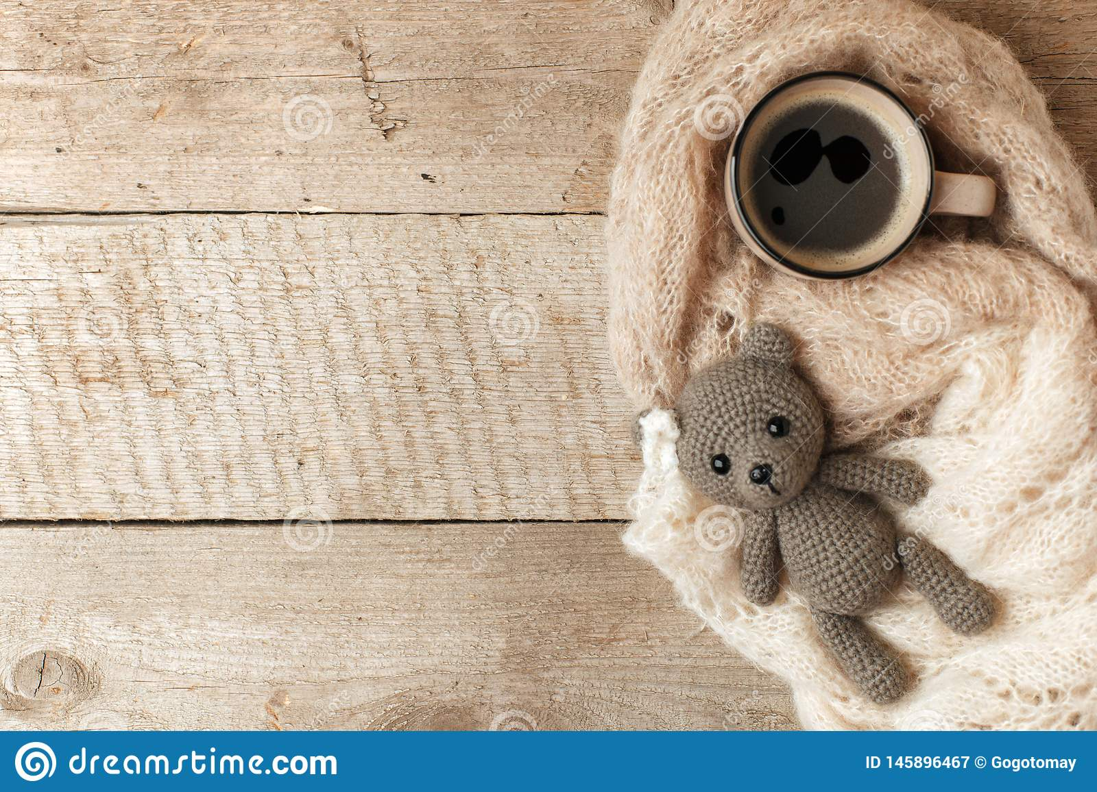 cozy-winter-autumn-morning-home-hot-coffee-warm-blanket-ghandcrafted-knitted-toy-bear-swedish-hygge-concept-monochrome-copy-145896467.jpg