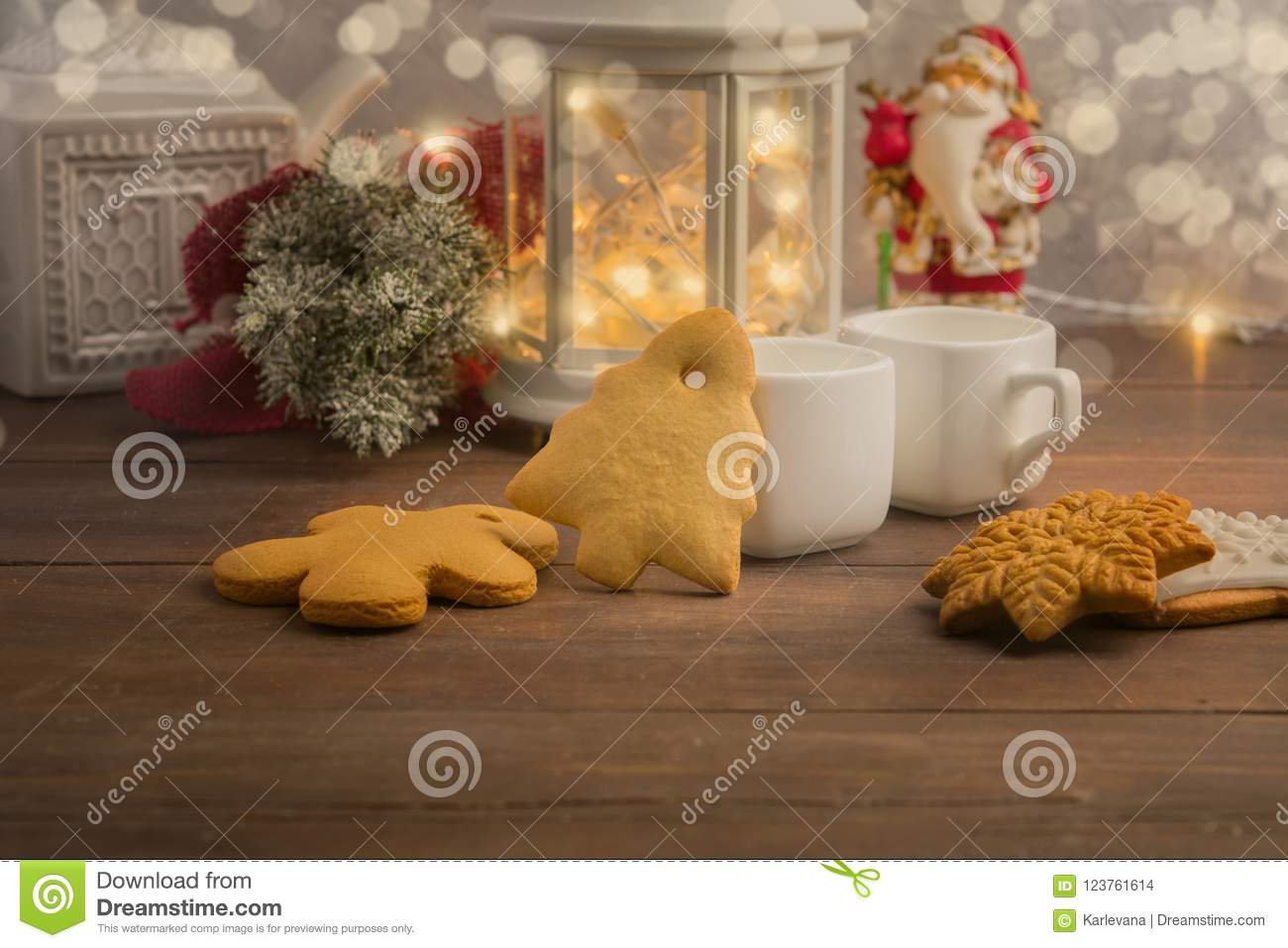 Cozy winter at home with hot drink and cookies. Christmas time with tea and garland