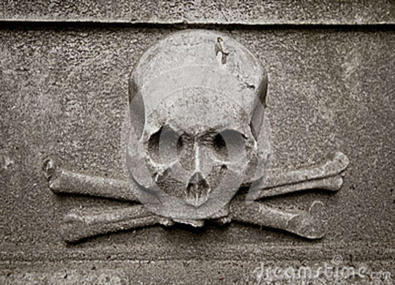Cráneo en la lápida mortuaria