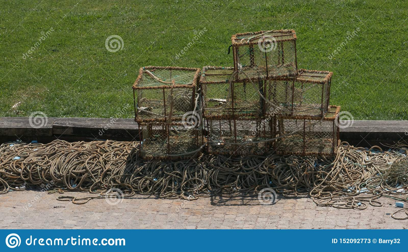Crab or Lobster pots drying in the sun on the dock in Portugal during summer