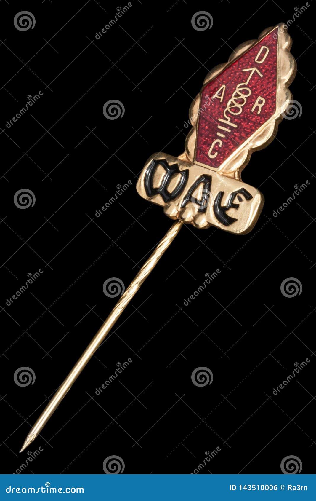 Crachá dourado de WAE
