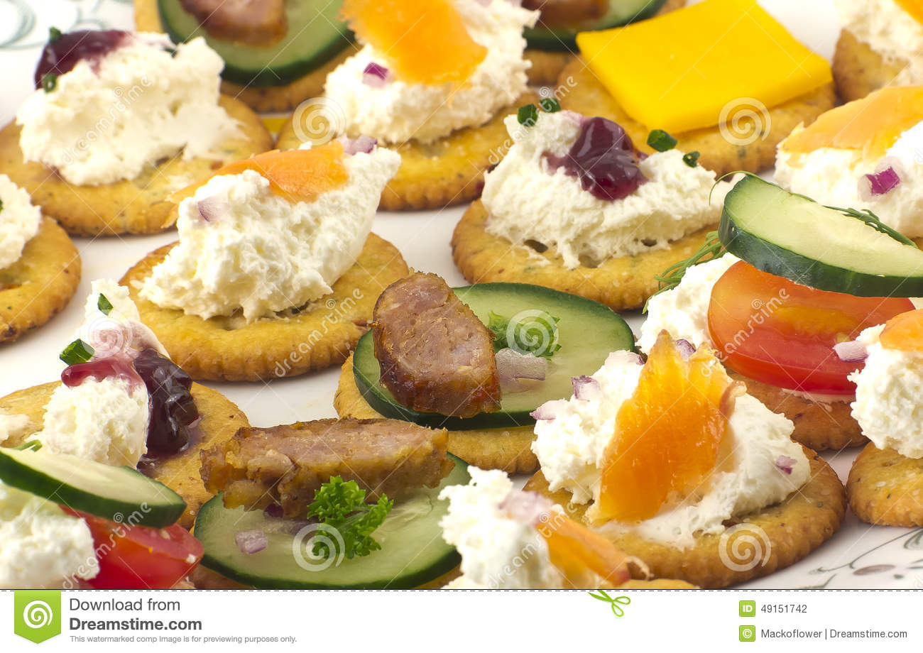 Crackers canopes with toppings stock photo image 49151742 for Canape toppings