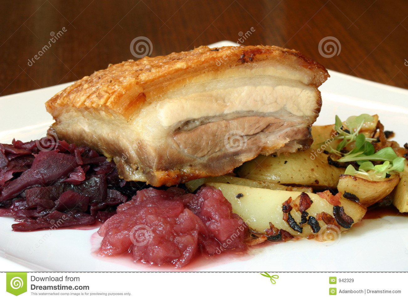 Crackling roast pork belly served with apple compote and sauteed ...