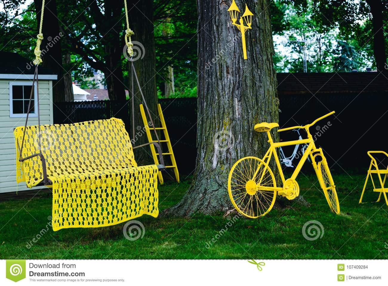 The cradle of childhood. Decorative art objects on the home yard. Summer or Autumn rest area.