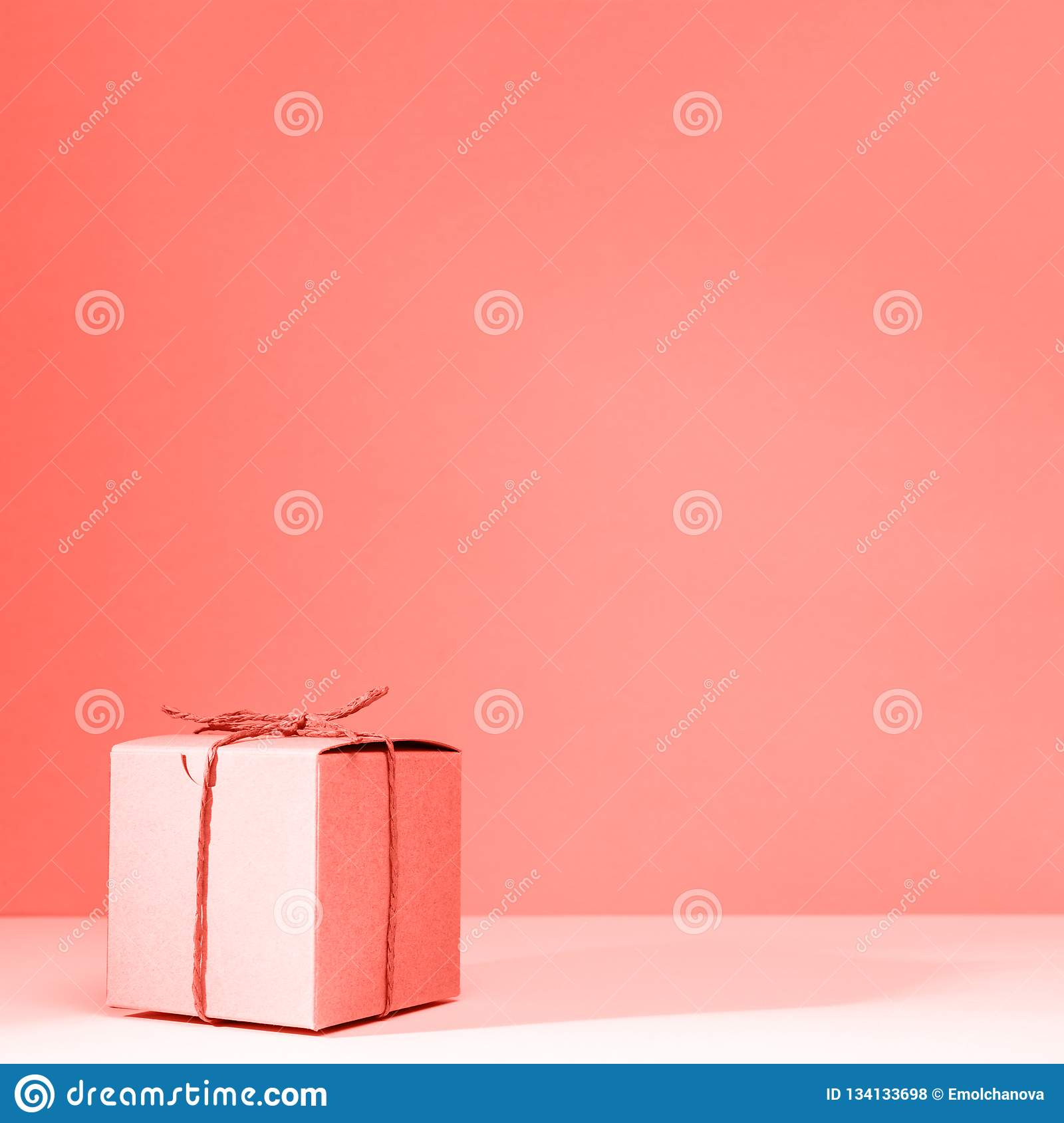 Craft Cardboard Gift Box On The Solid Pink Background Holiday And