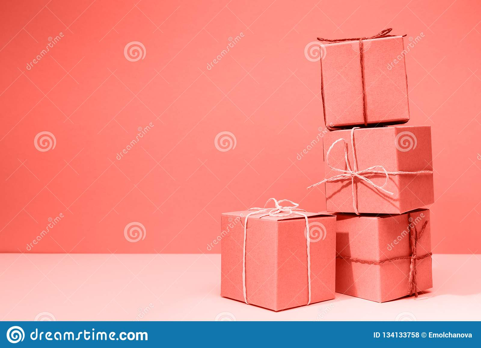 Craft Cardboard Gift Boxes On The Solid Pink Background Holiday And