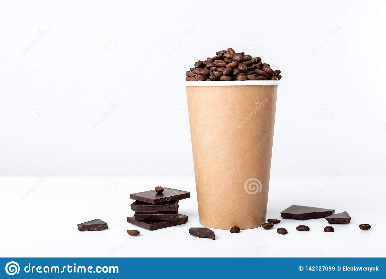 Craft coffee cup full of coffee beans wih chocolate on white background