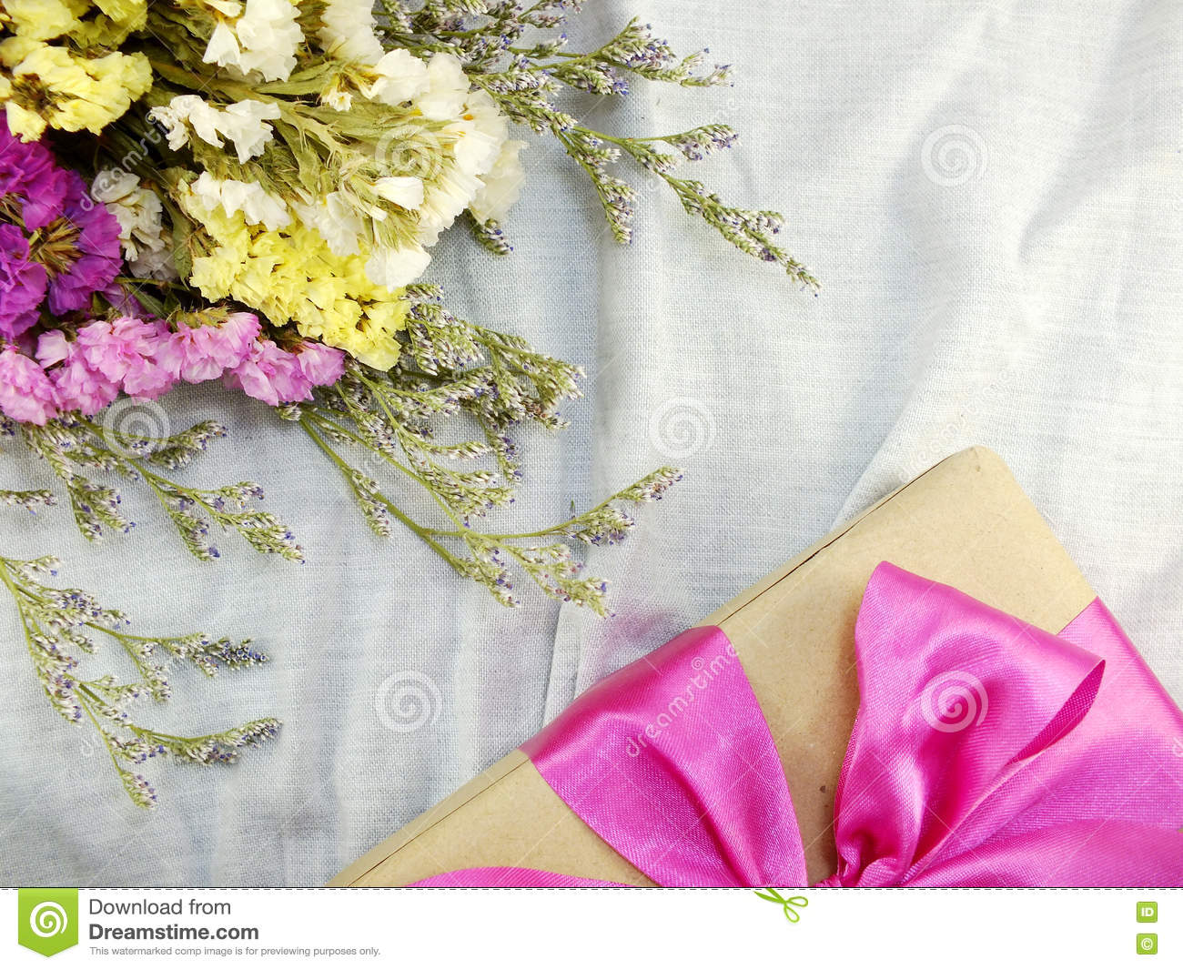 Craft Paper Gift Box With Ribbon Bow And Flower Bouquet Stock Image