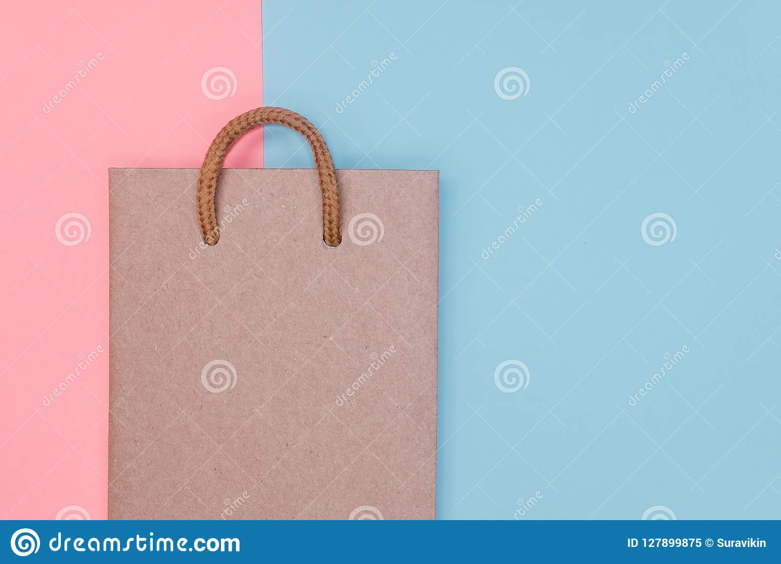 Craft Paper Shopping Bag On Paper Textured Backdrop Stock Image