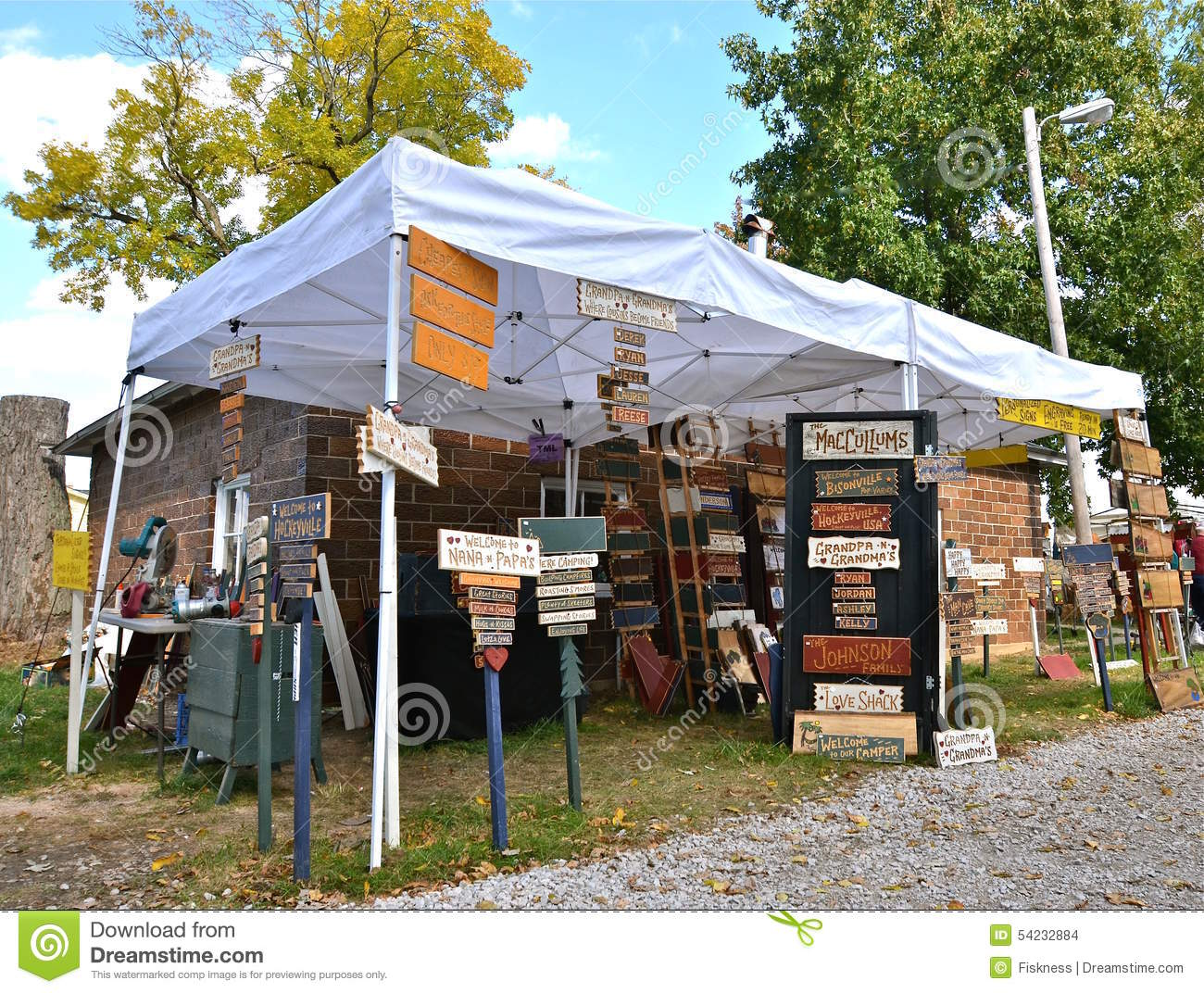 Craft show with carved signs editorial stock image image for Display tents for craft fairs