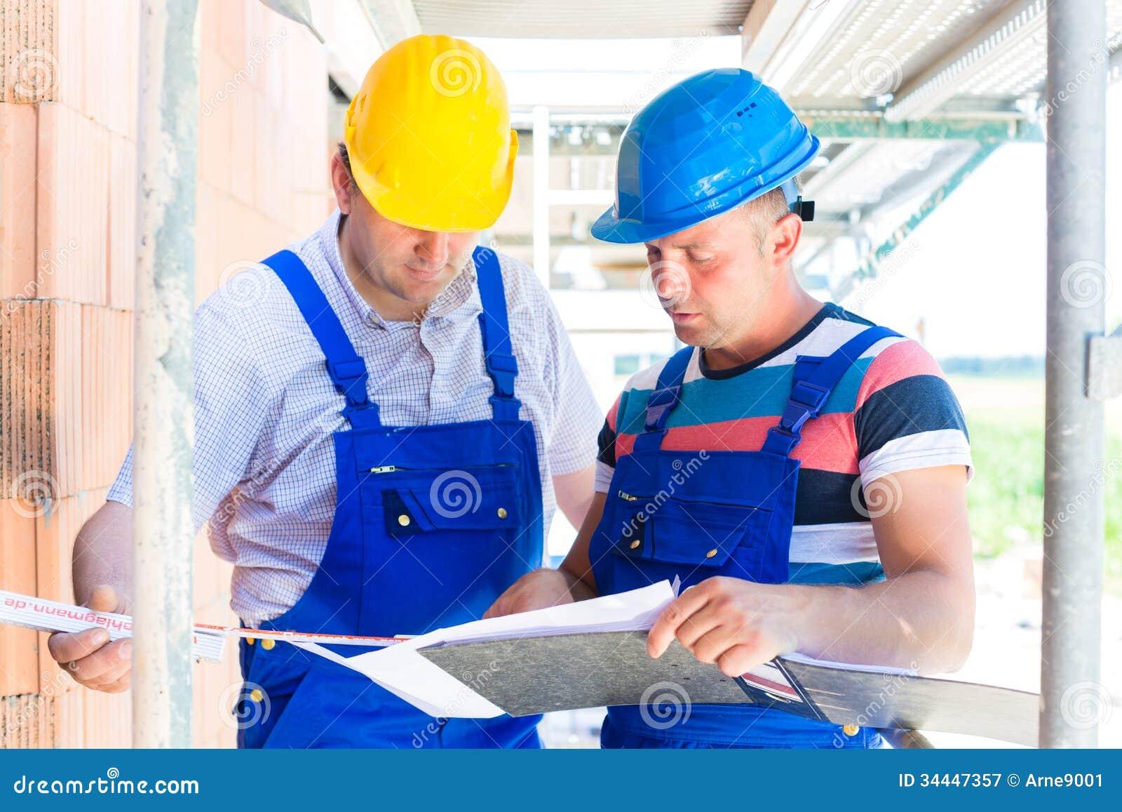 Craftsman controlling building site or construction plans