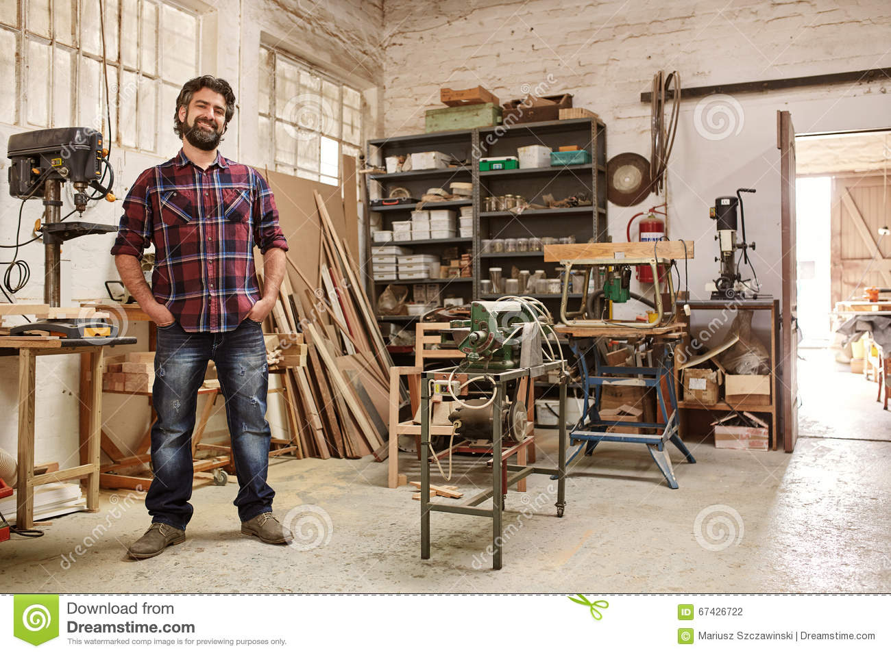 Craftsman in his workshop with heavy duty woodwork for Craftsman workshop