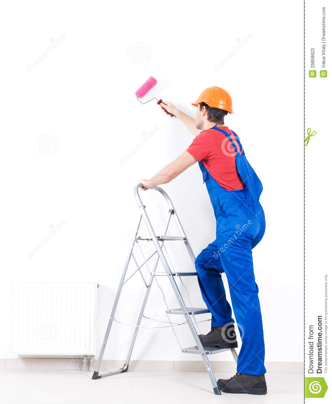 Craftsman painter stands on the stairs with roller full portrait over