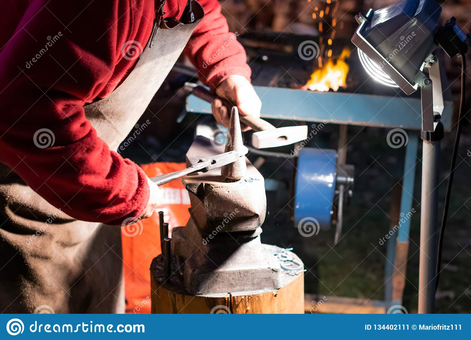 A Craftsman Working With Fire And A Hammer On A Glowing Iron  Middle
