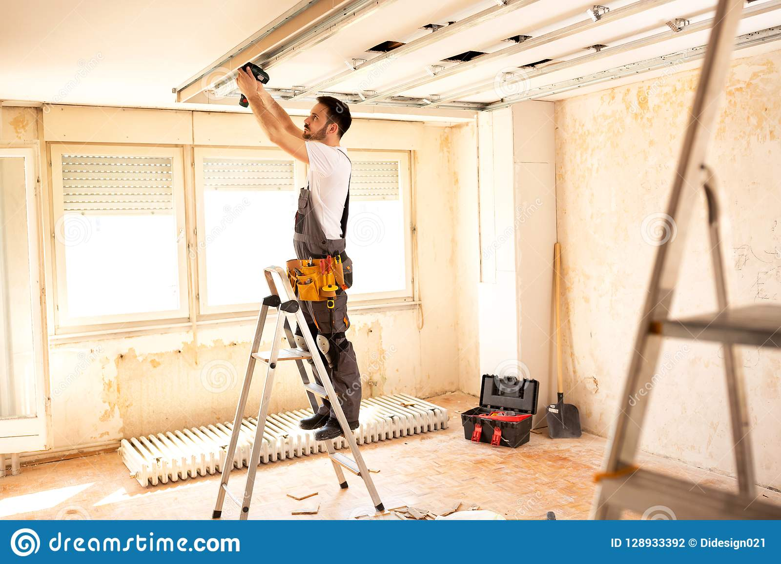 Crafty worker arranging ceiling construction