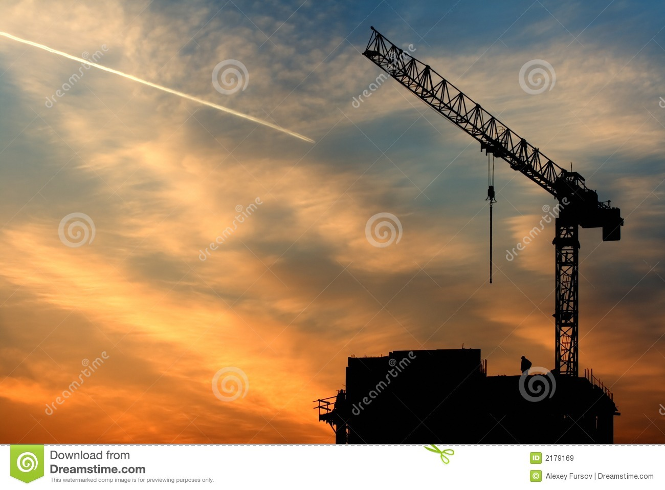 Crane, airplane and sunrise