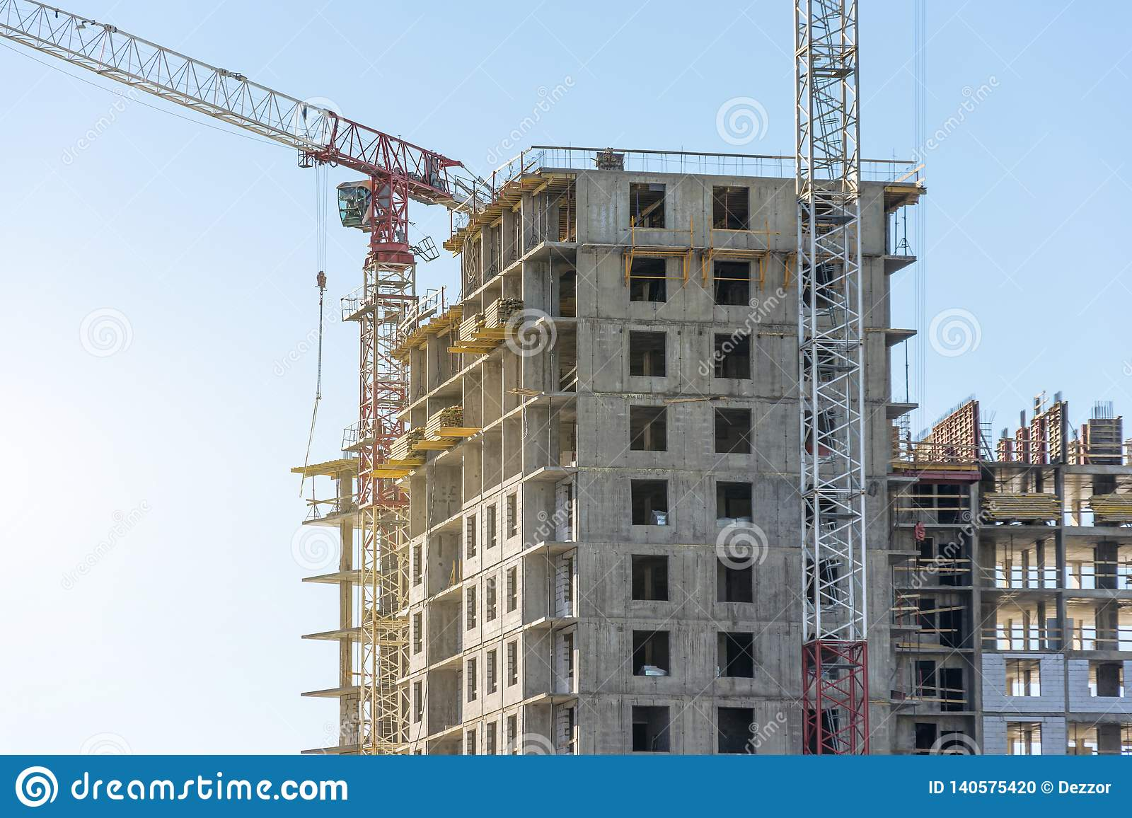 Crane and high-rise residential building. Real Estate Construction