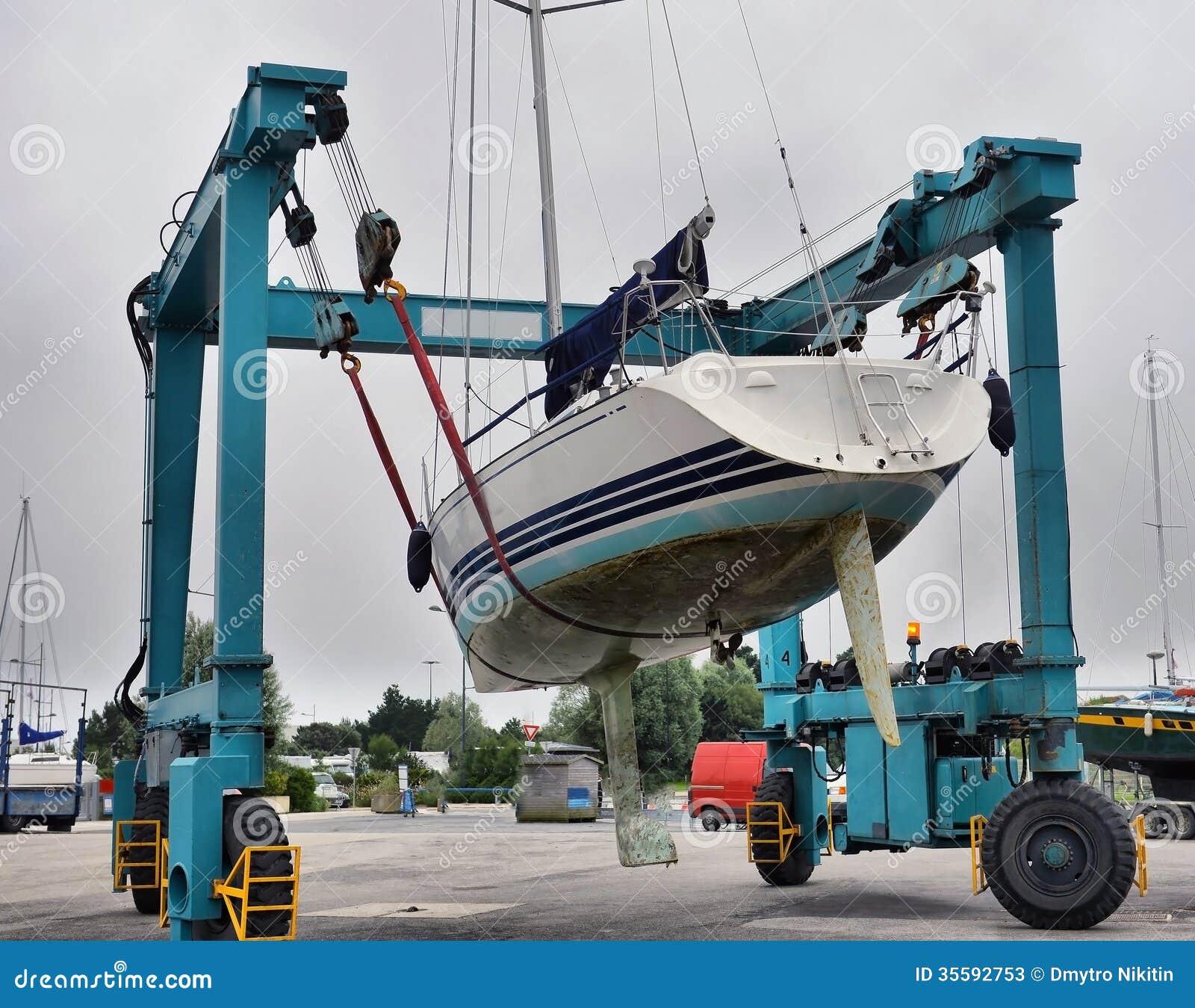 Crane lifting boats stock image. Image of ocean, equipment - 35592753