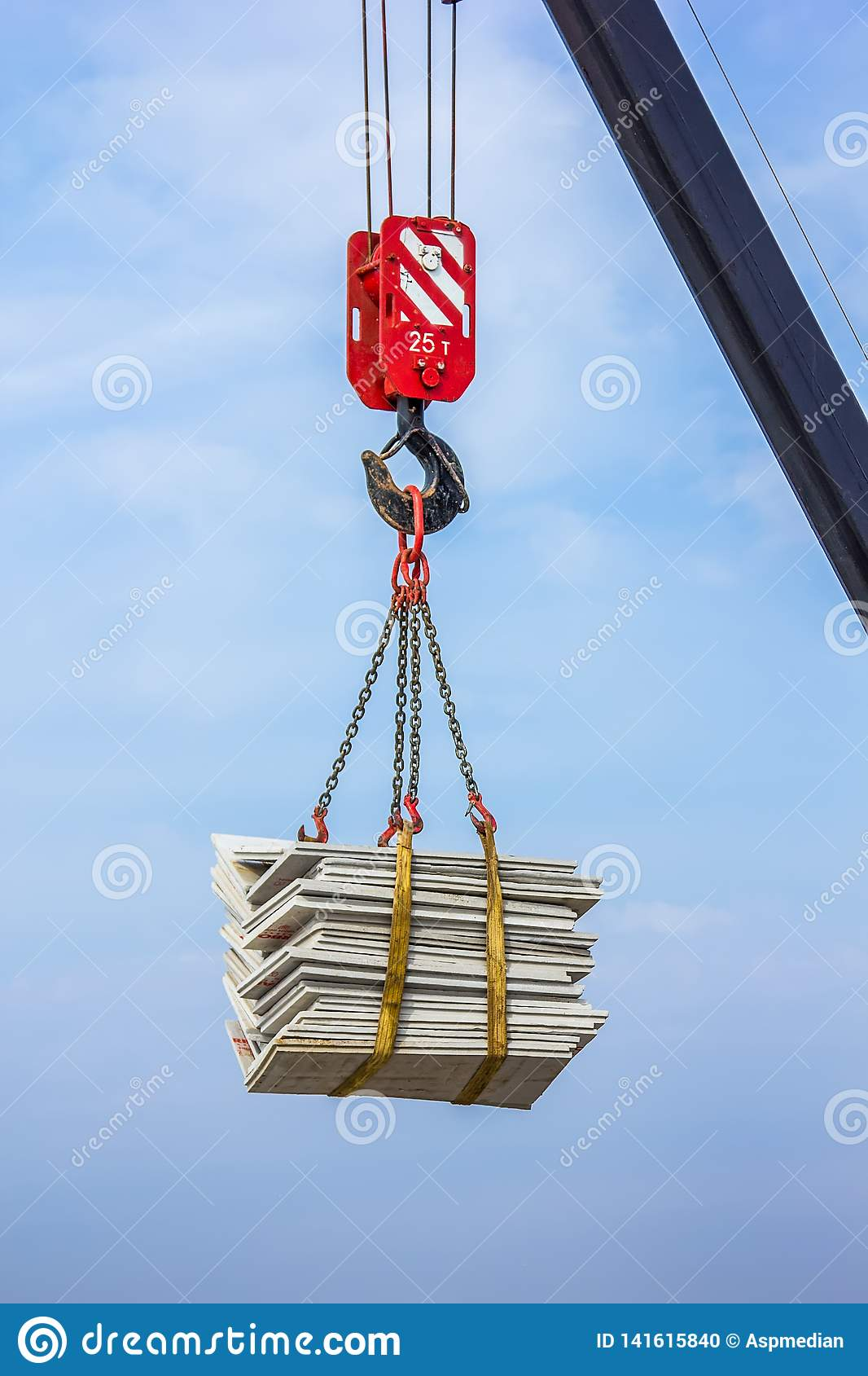 The crane lifts a heavy load on a hook