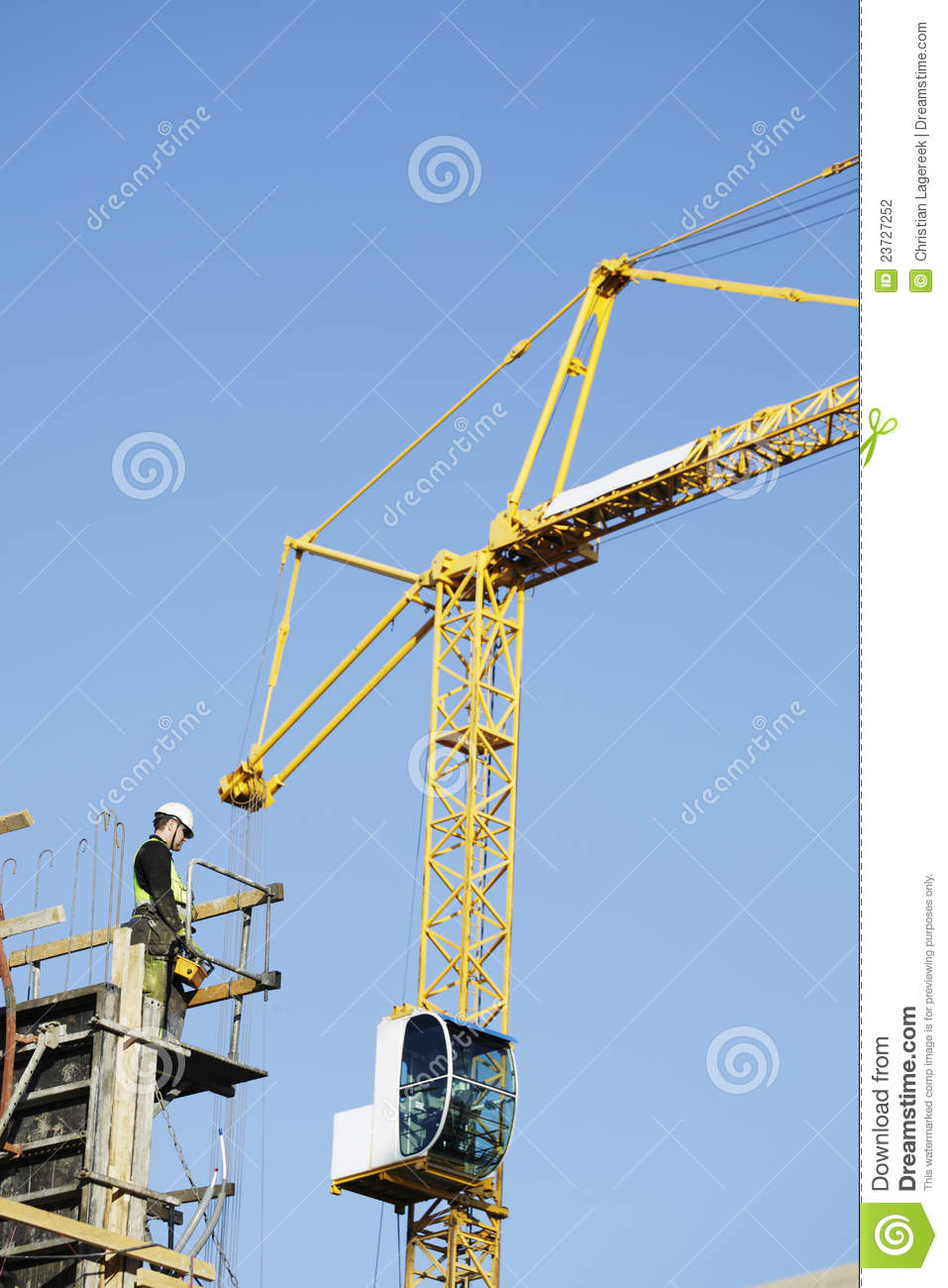 Large Standing Cranes Stencil: Crane Operator With Remote Control Stock Photography