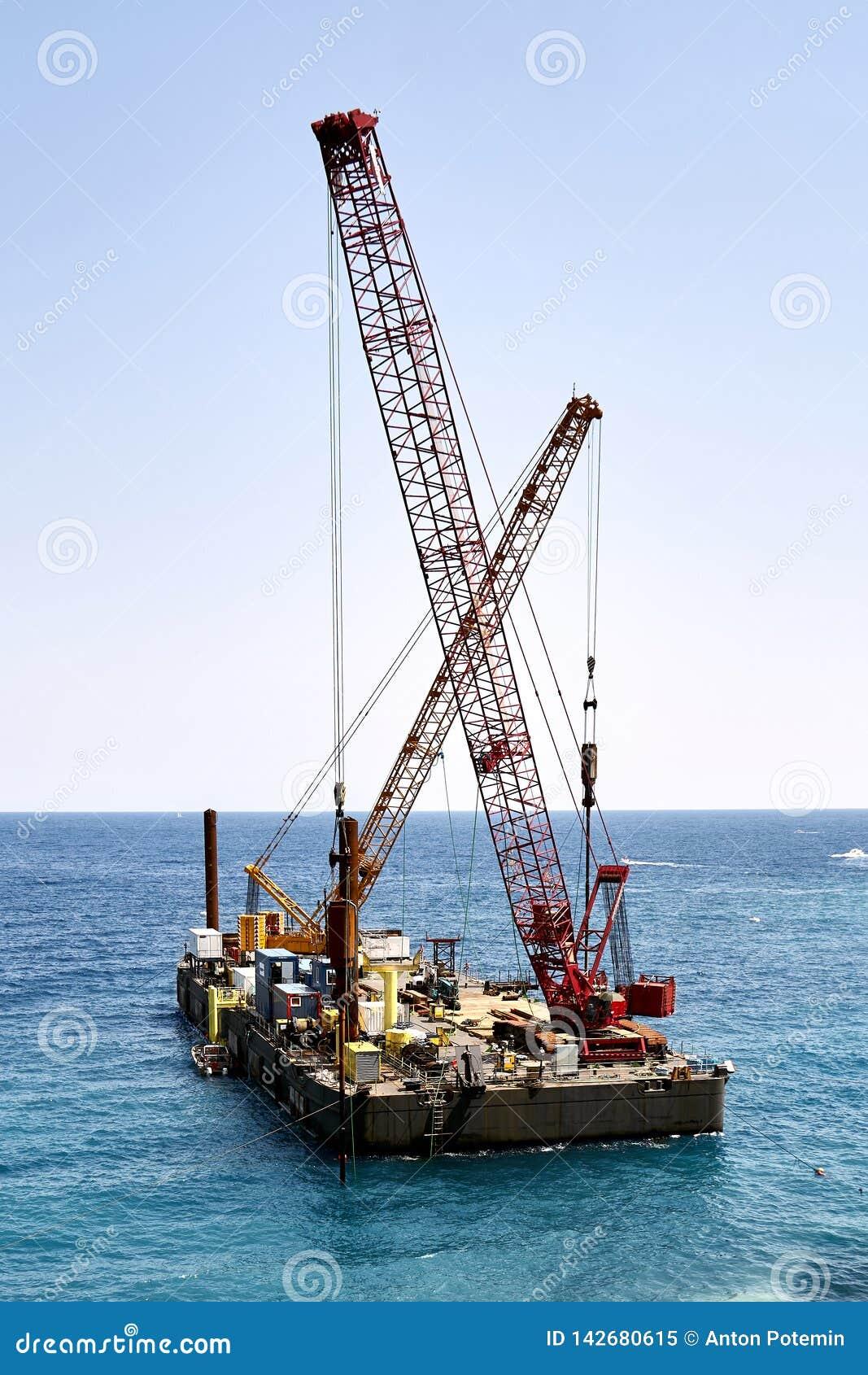Cranes on floating platform